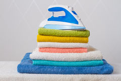 Iron and towels Royalty Free Stock Image