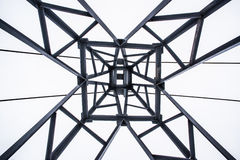 Iron tower shot from below. The symmetrical composition Stock Images