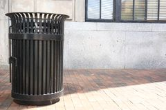 Iron Trash Can on City Street royalty free stock photos