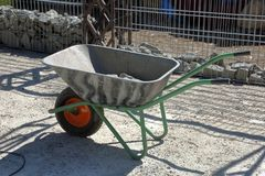 Manual household cart. Iron trolley for manual moving of building materials in the garden and in the backyard stock images