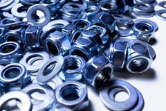 Iron washers and nuts mixed up close-up, texture, background stock photos
