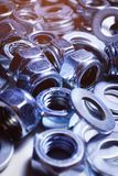 Iron washers and nuts mixed up close-up, texture, background royalty free stock photos