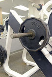 Iron weight plates and exercise equipment in gym Stock Photos