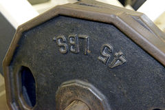 Iron weight plates and exercise equipment in gym Royalty Free Stock Photos
