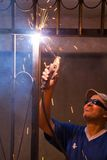 Iron Welding Electricity. Worker welding electricity iron with many sharp sparks Stock Photos