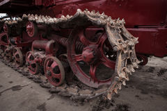 Iron wheel. Caterpillar vintage tractor for agricultural work Royalty Free Stock Photo