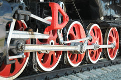 Iron wheels of the locomotive. Iron wheels of an old steam train Stock Photos