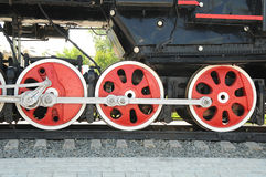 Iron wheels of the locomotive. Iron wheels of an old steam train Royalty Free Stock Photos