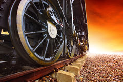 Iron wheels of stream engine locomotive train on railways track Stock Images