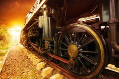 Iron wheels of stream engine locomotive train on railways track Stock Images
