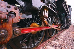 Iron wheels of stream engine locomotive train on railways track Stock Photos