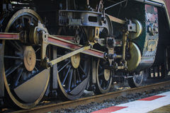Iron wheels of stream engine locomotive train on railways track Royalty Free Stock Photo