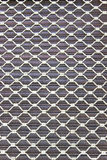 Iron window screen grid over wooden blinds Royalty Free Stock Image