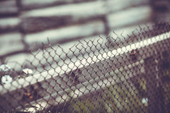 Iron wire fence on gray background Stock Images