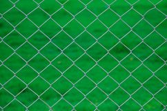 Iron wire fence green background Stock Image