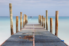 Iron and wood pier Royalty Free Stock Photo