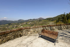 Iron and wooden bench over Lunigiana landscape, Fosdinovo Royalty Free Stock Image