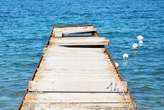 Iron wood bridge and water, in Tuscany, in Elba island, Italy Stock Image