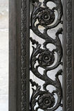 Iron work. Detailed decoration on iron fence with floral ornaments Stock Photography