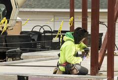 Iron worker welds beams Stock Photography
