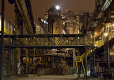 Iron works at night. Abandoned and rusty blast furnace, part of iron works, not anymore in function. It is a part of Vitkovice . In December 2008, the UNESCO Royalty Free Stock Images