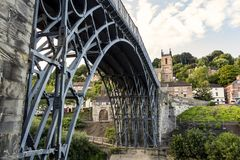 Ironbridge Shropshire - Underneath view showing Iron Works of the Structure. Showing the village of Ironbridge in the background Royalty Free Stock Photography