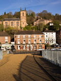 Ironbridge World Heritage Town, England. The historic town of Ironbridge, viewed from the footpath across the first iron bridge in the world, built in 1779. The royalty free stock image
