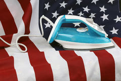 Ironed Crumpled US flag. Conceptual photography male hand with the included iron irons American Stripes Royalty Free Stock Photo