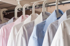 Ironed shirts in the closet. Organize closeup royalty free stock images