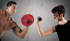 Ironic comparison of muscle strength Stock Photography