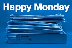Ironic Happy Monday Concept in Blue. A Full To Do Tray and the Words Happy Monday on Blue Background stock photos