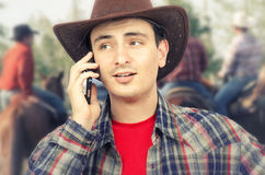 Ironic little smile of cowboy lips calling on phone Royalty Free Stock Images