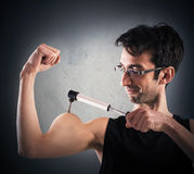 Ironic muscular man Stock Images