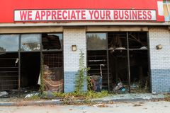Ironic Sign Sits Atop Burned Out And Vandalized Small Business. Atlanta, GA, USA - September 23, 2017:  A sign reading `We appreciate your business` sits above a Stock Photography