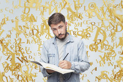 Ironical guy in jeans shirt and gold letters Stock Photography