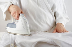 Ironing. Somebody ironing a collared shirt. White. Housework series Royalty Free Stock Image