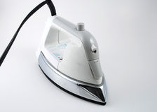 Ironing. Close up picture of an iron used to remove wrinkles from clothes Royalty Free Stock Photography