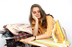 Ironing. Young woman very listless at an iron board Stock Image