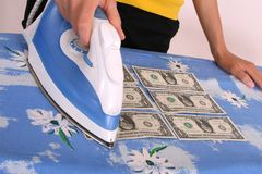 Ironing american dollars Royalty Free Stock Photos