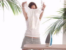 Ironing a blouse Royalty Free Stock Images