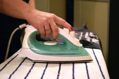 Ironing board, iron and clothes Royalty Free Stock Photography