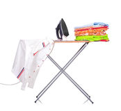 Ironing board with a man's shirt Stock Image