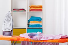 Ironing and cleaning at home Stock Photos