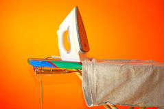 Ironing clothes. On an ironing board ready to use. House work Royalty Free Stock Images