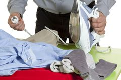 Ironing clothes. How difficult it is for a man ironing clothes Stock Photo