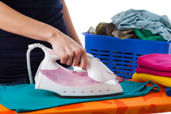 Ironing and clothes in a basket Stock Photo