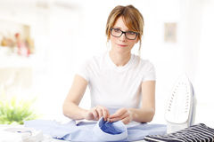 Ironing clothes Stock Image