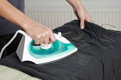 Ironing clothes Royalty Free Stock Photo