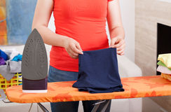 Ironing clothes at home Stock Images