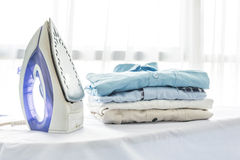 Ironing, clothes, housework and objects concept Stock Images